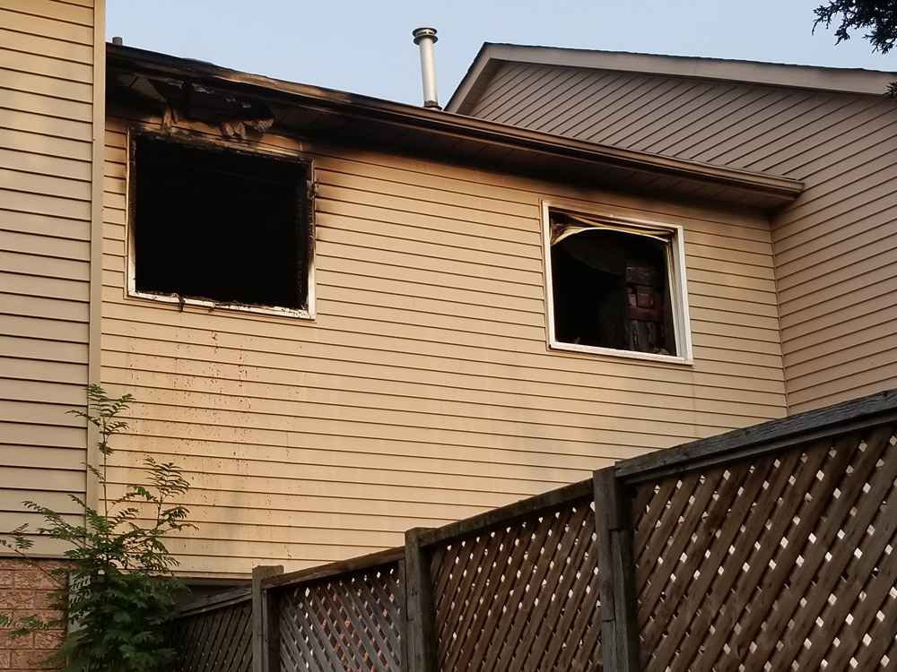 Smoke and fire damage to the second storey windows of a home on Vail Meadows Crescent in Bowmanville.