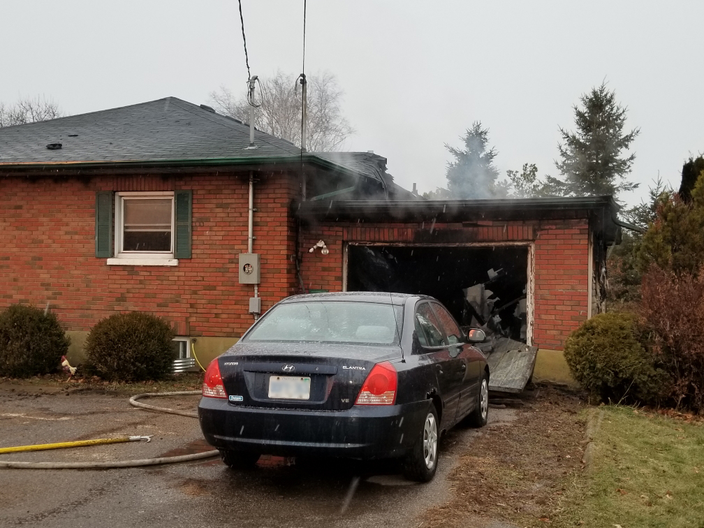 Smoke and fire damage to the garage and roof of a home near Concession Road 4 and Highway 115.