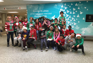 students wearing ugly Christmas sweaters