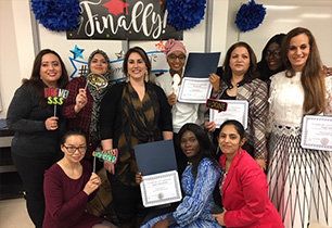 Group of female adults holding their program completion certificates