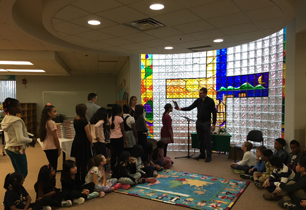 Students receive their bibles from Priest at a ceremony in the school's Learning Commons