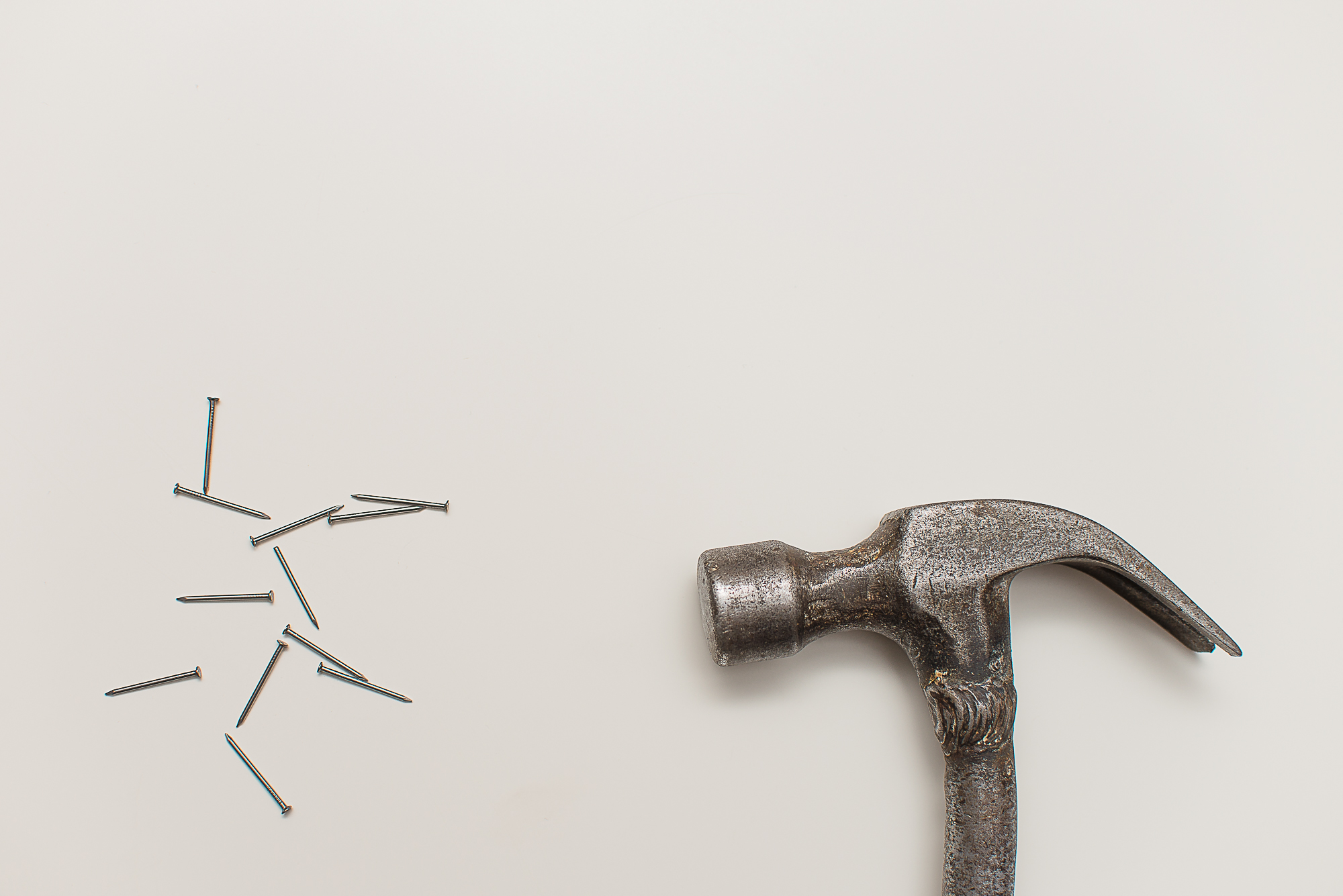 Photo of hammer and nails by Patryk Dziejma
