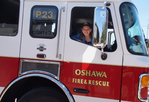 Female student sitting in the fire truck