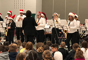 High school band performs for elementary school students