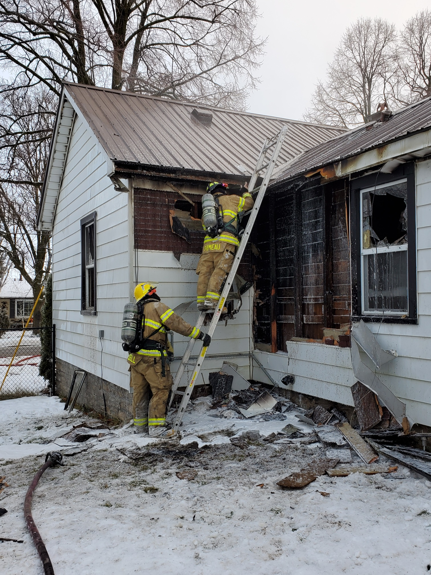Two St. Marys Firefighters investigate the cause of the recent house fire at 500 Queen Street East.