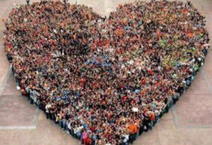 Group of people forming a solid heart