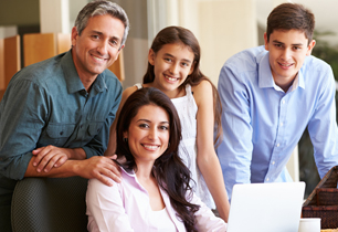 Parents with son and daughter looking at a computer