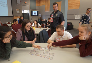 Teacher play card game with students