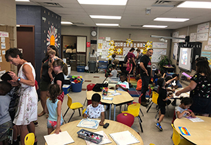 Students showing parents around the Summer Rays classroom