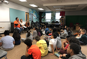 Students listening to a male adult speak about Residential Schools