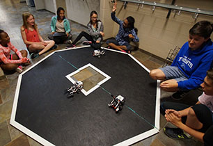 Male & female students competing in a sumbot challenge