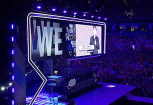 WE Day sign on big screen in arena