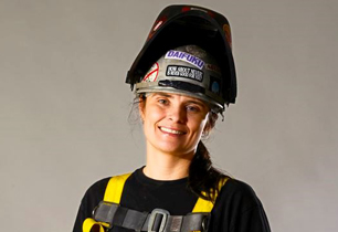 female adult wearing a hard hat and construction clothing