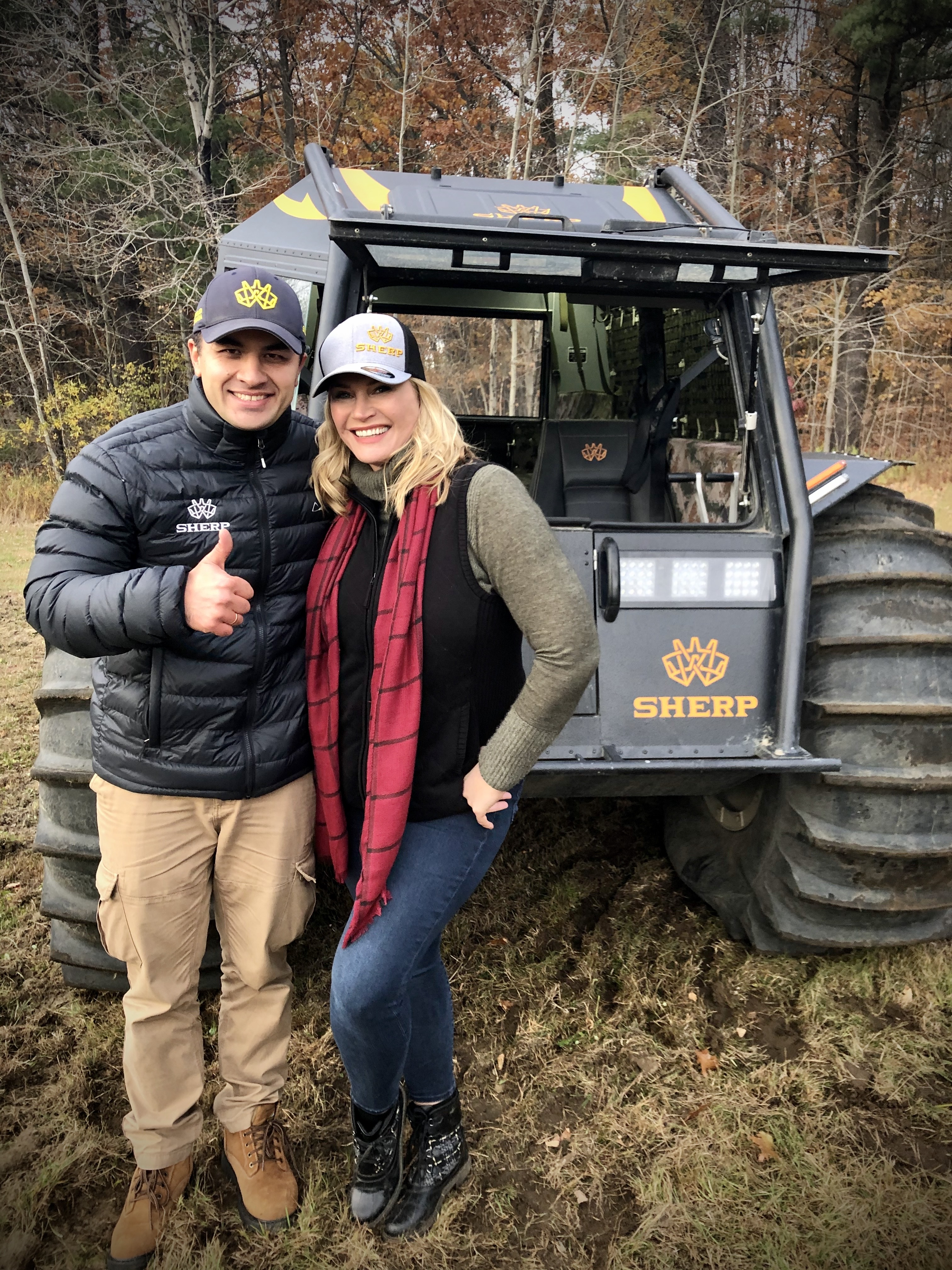 Evgeny Astakhov, Sales Manager, SHERP and Natasha Henstridge, in front of the SHERP on the set.