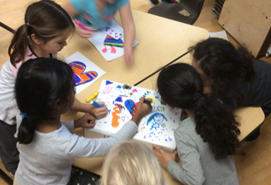 students colouring pictures