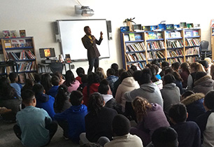 Male adult speaking to students