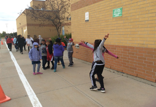 Students outside stretching before the Terry Fox run and walk