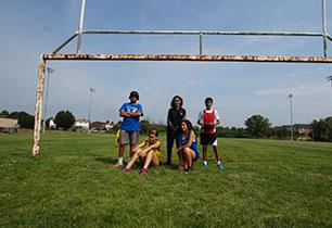 Msle & female students outside holding football