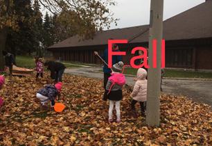 students raking leaves