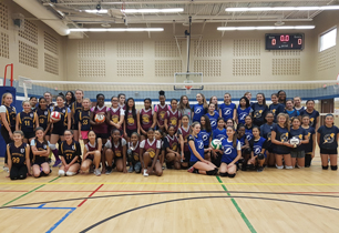 Girls from all four schools gather for a picture in their team uniforms