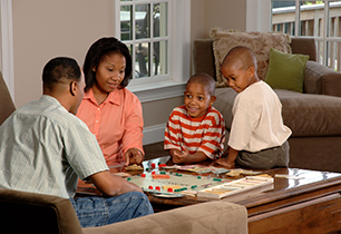 A family playing a board game at home