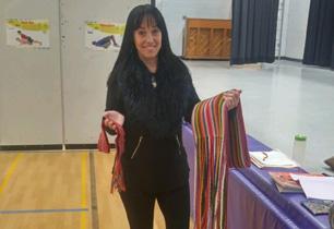 Female adult holding Metis sash