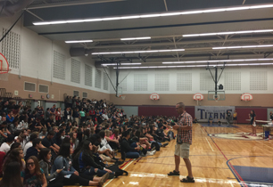 Students sitting in the bleacher in school gym