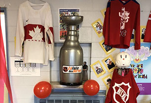 Hockey jerseys and inflatable Stanley Cup by front office for school