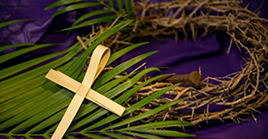 Cross made from a palm leaf, palm branch and crown of thorns