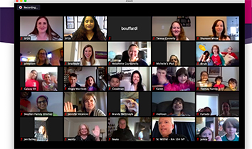 Faces of men, women and children on a computer screen meeting virtually