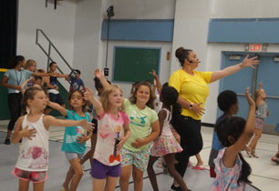 Students dance around the gym learning the tango