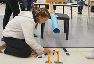 Female student setting up her science project