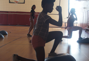 female student doing lunges