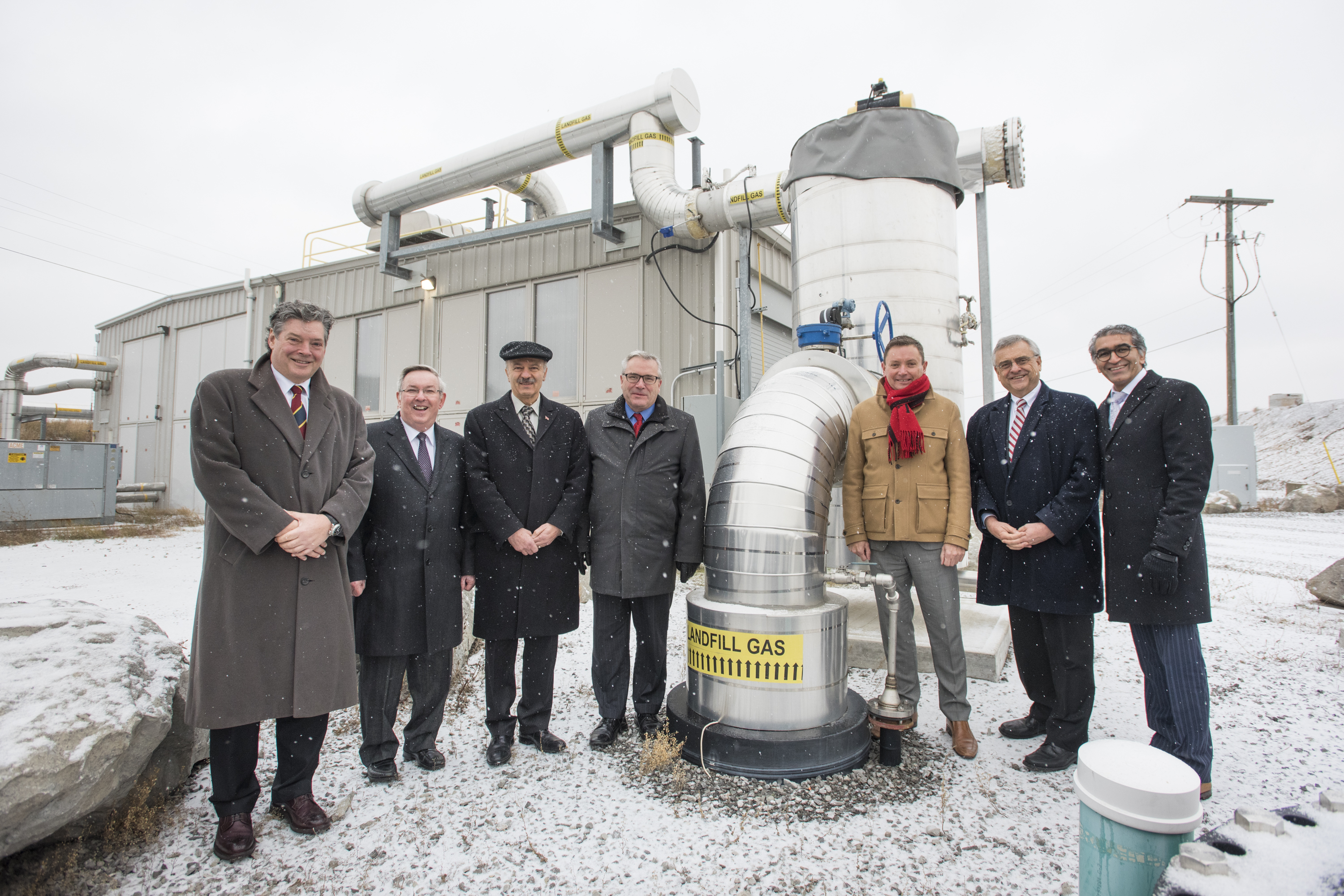 At the Walker (IGRS) landfill gas plant on December 8, 2017. L-R: David Paterson, Vice President of Corporate and Environmental Affairs, General Motors; Jim Bradley, MPP St. Catharines; Dr. Reza Moridi, Minister of Research, Innovation and Science; Chris Ballard, Minister of the Environment and Climate Change; Mike Watt, Executive Vice President, Walker Environmental; Dr. Tom Corr, President and CEO, Ontario Centres of Excellence; Parminder Sandhu, Green Ontario Fund Board Chair.