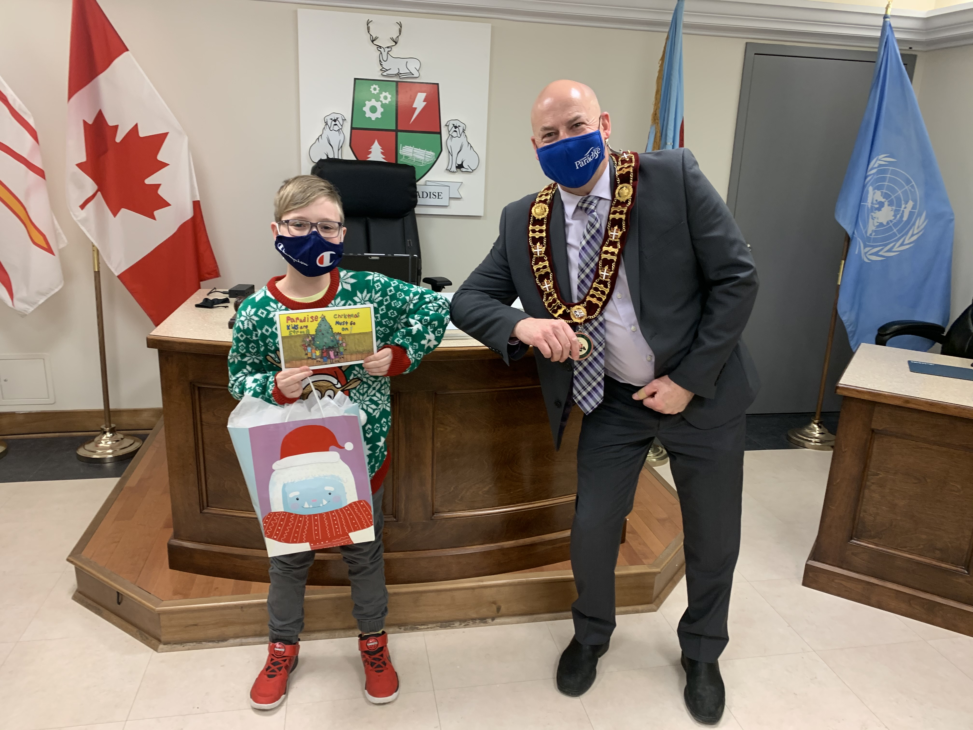 Paradise Mayor Dan Bobbett presenting Andy Walker, a Grade 5 Student from Paradise Elementary, his prize for designing the Town's 2020 Christmas Card